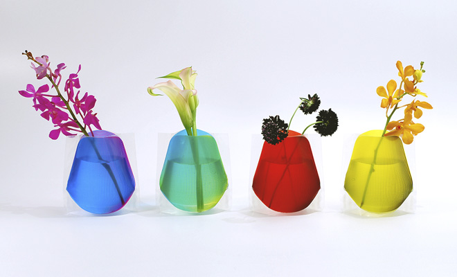 a set of four popup vinyl vases in bright colors